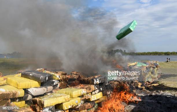 14182 kilos of seized marijuana are incinerated in Asuncion on June 29 2018 The drug was seized on Moday in Guayaibi San Pedro department as it was...