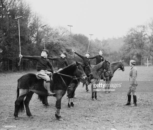 AB Kilroy teaching boys from St Andrew's Preparatory school Pangbourne to play polo at her riding school at Bradfield Berkshire 17th November 1936