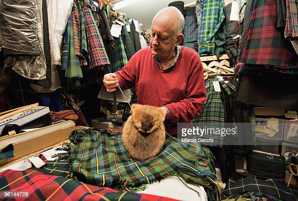 A kiltmaker put the final touches to a musquash sporran to be collected for Burns night on January 23 2010 in London England Scots across the world...
