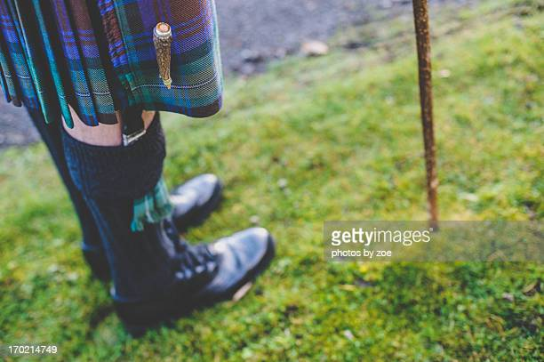 kilts and walking sticks - scottish culture stock pictures, royalty-free photos & images