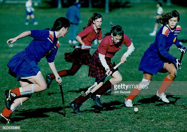 Kilts swirl as Macdonald rushes field Defenders from Sir Oliver Mowat Collegiate in blue try to thwart a Sir John A Macdonald stickhandler Mowat won...