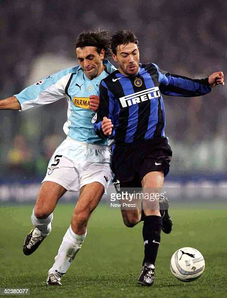 Kily Gonzalez of Inter Milan struggles for the ball against Sebastiano Siviglia of Lazio during their match March 12 2005 in Stadio Olimpico in Rome...