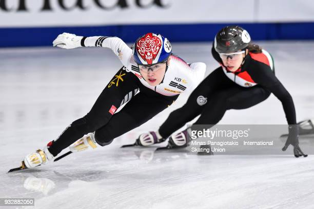 Kim A Lang of Korea competes against Petra Jaszapati of Hungary in the women's 1500 meter heats during the World Short Track Speed Skating...