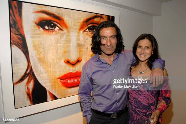 Kim Allouche and Eric Allouche attend Opera Gallery Opening Voigt Monet and Vukelic at Opera Gallery on April 15 2010 in New York City