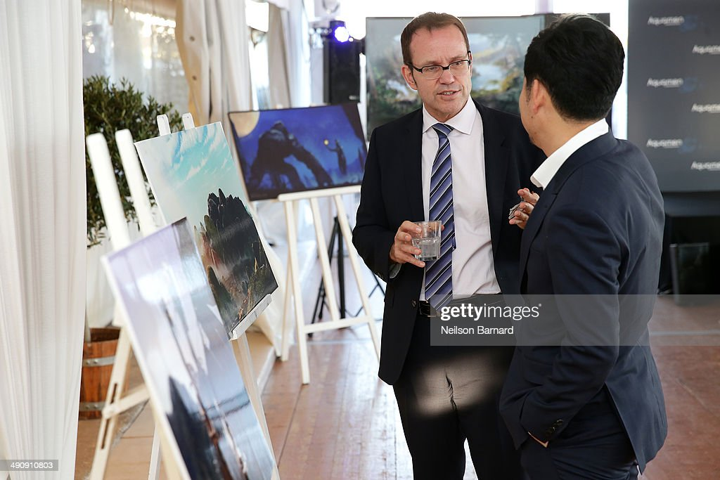 JJ Kim (R) and guest attend the 2014 Cannes Aquamen KONG Event At Mandala Beach / Cheri Cheri during the 67th Annual Cannes Film Festival at Mandala Beach on May 15, 2014 in Cannes, France.