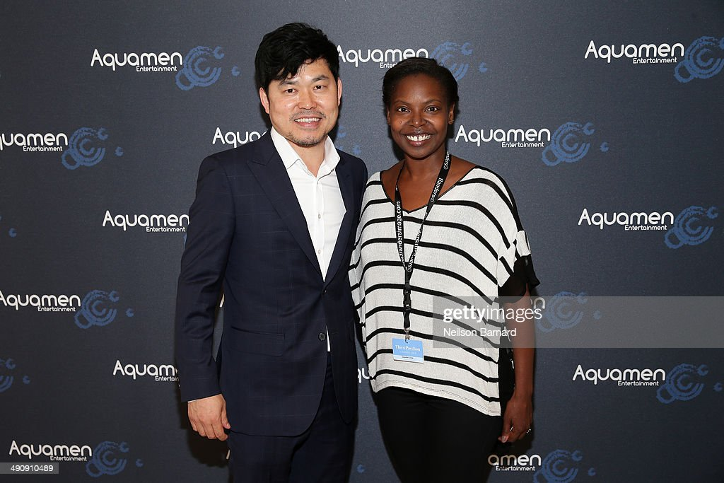 JJ Kim (L) and Jacqueline Lyanga attend the 2014 Cannes Aquamen KONG Event At Mandala Beach / Cheri Cheri during the 67th Annual Cannes Film Festival at Mandala Beach on May 15, 2014 in Cannes, France.