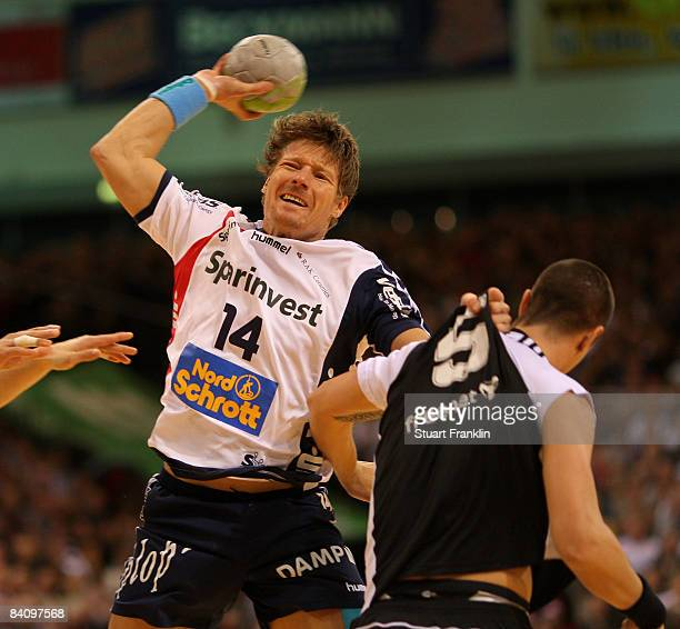 Kim Andersson of Kiel challenges Johnny Jensen of Flensburg during the Toyota Handball league game between SG FlensburgHandewitt and THW Kiel at the...