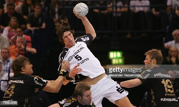 Kim Andersson of Kiel in action with Kasper Nielsen of Flensburg and his team mates Jonny Jensen and Soeren Stryger during the Handball German Cup...
