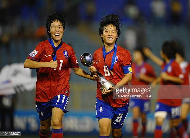 Kim Areum and Lee Geum Min of South Korea celebrate with the trophy after victory over Japan during the FIFA U17 Women's World Cup Final between...