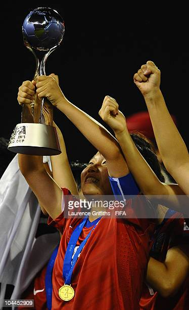 Kim Areum of South Korea raises the trophy after victory over Japan during the FIFA U17 Women's World Cup Final between South Korea and Japan at the...