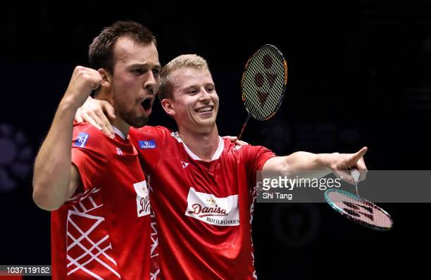 Kim Astrup and Anders Skaarup Rasmussen of Denmark celebrate the victory after their Men's Doubles quarter finals match against Liu Yuchen and Li...