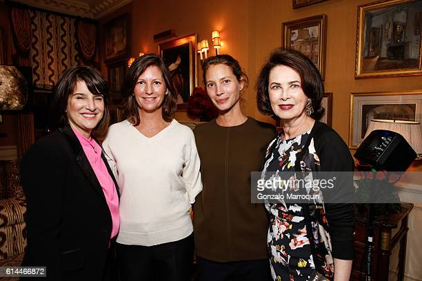 Kim AzzarelliKelly Burns Christy Turlington Burns and Dayle Haddon at the WomenOne Dinner on October 13 2016 in New York City