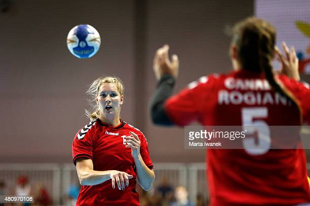 JULY 16 Kim Barette of Canada passes the ball to teammate Janel Rogiani during the Women's Preliminary Round Handball game between Canada and Mexico...