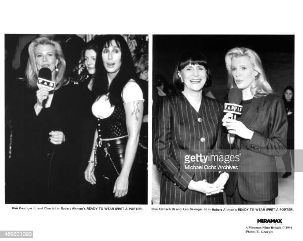 "Kim Basinger interviews Cher, with Chiara Mastroianni behind them; Elsa Klensch and Kim Basinger attend the premiere of movie ""Pret-a-Porter "" aka..."