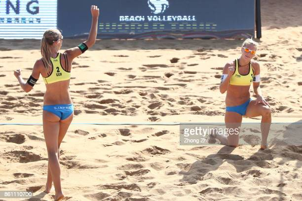 Kim Behrens of Germany celebrates with Sandra Ittlinger of Germany during the match against Brooke Sweat and Summer Ross of the United States on Day...