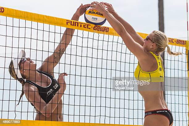 Kim Behrens of Germany fights against Brandie Wilkerson of Canada during a qualification match of the 2014 FIVB Beach Volleyball World Tour on May 09...
