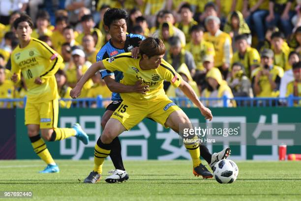 Kim Bo Kyung of Kashiwa Reysol and Hidemasa Morita of Kawasaki Frontale compete for the ball during the JLeague J1 match between Kashiwa Reysol and...