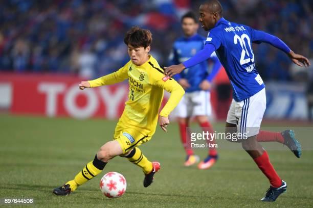 Kim Bo Kyung of Kashiwa Reysol and Martinus of Yokohama FMarinos compete for the ball during the 97th Emperor's Cup semi final match between Yokohama...