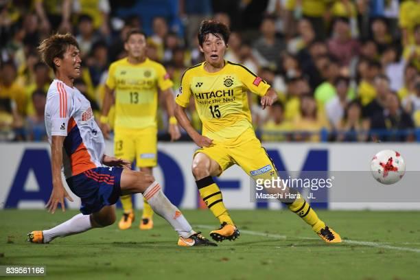 Kim Bo Kyung of Kashiwa Reysol and Song Ju Hun of Albirex Niigata compete for the ball during the JLeague J1 match between Kashiwa Reysol and Albirex...
