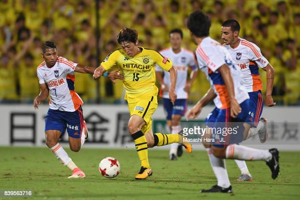 Kim Bo Kyung of Kashiwa Reysol controls the ball under pressure of Albirex Niigata defense during the JLeague J1 match between Kashiwa Reysol and...
