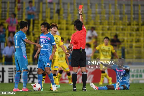 Kim Bo Kyung of Kashiwa Reysol is shown a red card by referee Nobutsugu Murakami after fouling on Victor Ibarbo of Sagan Tosu during the JLeague J1...