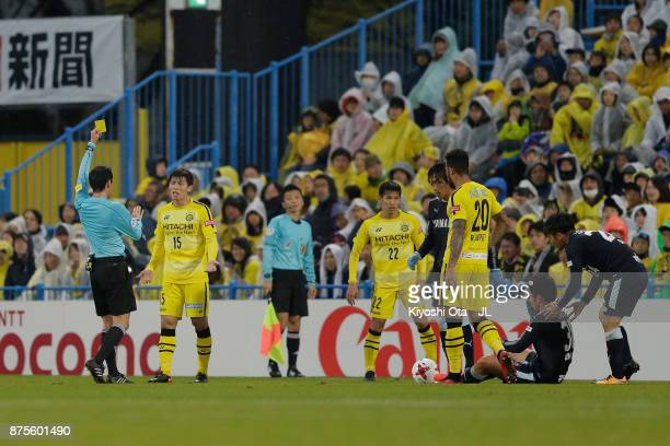 Kim Bo Kyung of Kashiwa Reysol is shown a yellow card by referee Hiroyuki Kimura during the JLeague J1 match between Kashiwa Reysol and Jubilo Iwata...