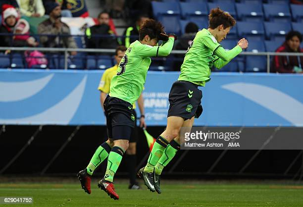 Kim Bokyung of Jeonbuk Hyundai Motors FC celebrates scoring the first goal to make the score 10 with teammate Lee Jaesung oduring the FIFA Club World...