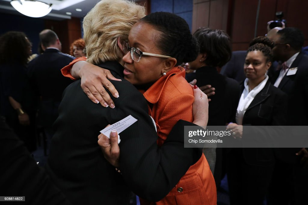 Kim Bose (C), mother of murdered Hampton University student Joseph Bose, is embraced by Sen. Debbie Stabenow (D-MI) follow meeting with U.S. Senate Democrats in the visitors center at the U.S. Capitol March 7, 2018 in Washington, DC. Senate Democrats called the meeting to hear from people who they said were missing from the debate on guns, including the parents of young gun violence victims from Florida, Virginia and Connecticut; law enforcement officials; students and teachers.