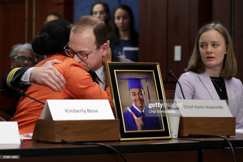 Kim Bose (L), mother of murdered Hampton University student Joseph Bose, is embraced by Prince George's County Police Chief Hank Stawinski as Oregon high school student Eva Jones (R) looks on during a meeting with U.S. Senate Democrats in the visitors center at the U.S. Capitol March 7, 2018 in Washington, DC. Senate Democrats called the meeting to hear from people who they said were missing from the debate on guns, including the parents of young gun violence victims from Florida, Virginia and Connecticut; law enforcement officials; students and teachers.