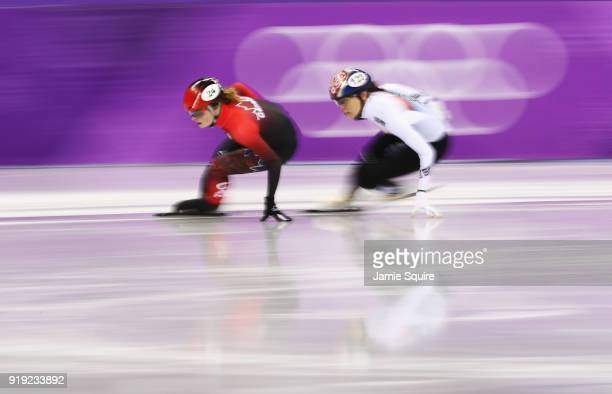 Kim Boutin of Canada and Alang Kim of Korea compete during the Short Track Speed Skating Ladies' 1500m heats on day eight of the PyeongChang 2018...