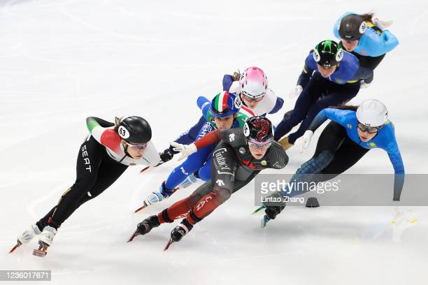 Kim Boutin of Canada and Gloria Ioriatti of Italy lead the pack in the Ladies 1500m quarterfinals during the day one of ISU World Cup Short Track at...