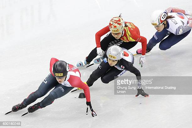 Kim Boutin of Canada and Hitomi Saito of Japan compete in the Ladies 1000m Qarterfinals during the ISU World Cup Short Track 2016 on December 18 2016...