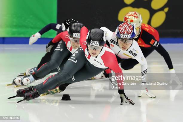 Kim Boutin of Canada and Shim SukHee of South Korea compete in the Ladies 1000m Semifinals during during the Audi ISU World Cup Short Track Speed...
