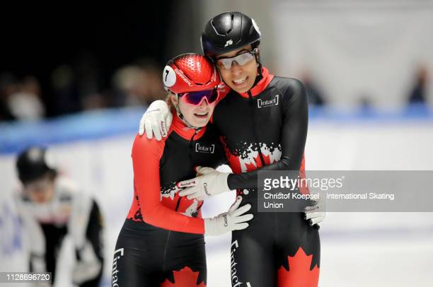 Kim Boutin of Canada celebrates her victory with third place winner Alyson Charles of Canada after the ladies 1000 meter final A during the ISU Short...