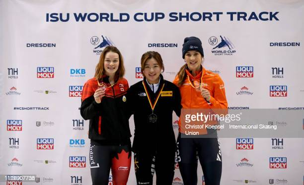 Kim Boutin of Canada celebrates the second place Kim Jiyoo of Republic of Korea celebrastes the firtts and Suzanne Schulting of Netherlands...