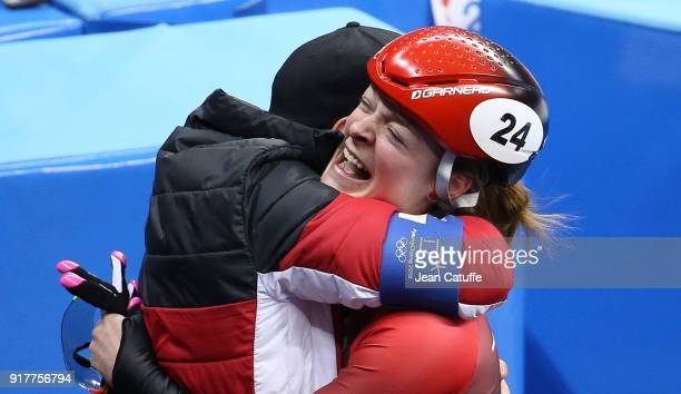 Kim Boutin of Canada celebrates winning the bronze medal after Choi Minjeong of South Korea is disqualified following the Ladies' 500m Short Track...