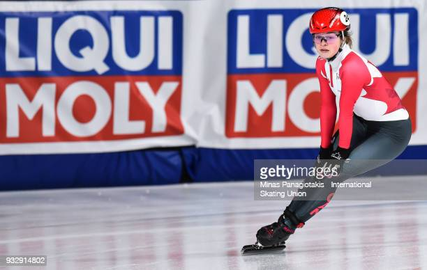 Kim Boutin of Canada finishes first in her group after competing in the women's 1000 meter heats during the World Short Track Speed Skating...