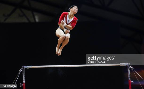 TOPSHOT Kim Bui of Germany competes in the women's uneven bar qualification during day three of the 48th FIG Artistic Gymnastics Championships at the...