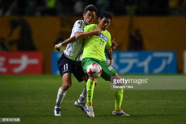 Kim Byeom Yong of JEF United Chiba and Kazuyoshi Miura of Yokohama FC compete for the ball during the JLeague J2 match between JEF United Chiba and...