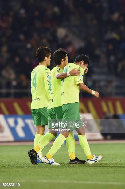 Kim Byeom Yong of JEF United Chiba is consoled by Koki Kiyotake after their 24 defeat in the JLeague J1 Promotion PlayOff semi final match between...