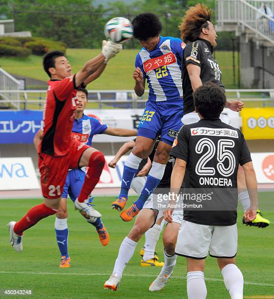 Kim ByeomYong of Montedio Yamagata scores his team's sixth goal during the JLeague second division match between Montedio Yamagata and Tochigi SC at...