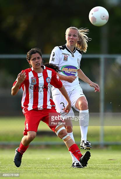 Kim Carroll of the Glory passes the ball against Alex Chidiac of City during the round three WLeague match between Perth Glory and Melbourne City FC...