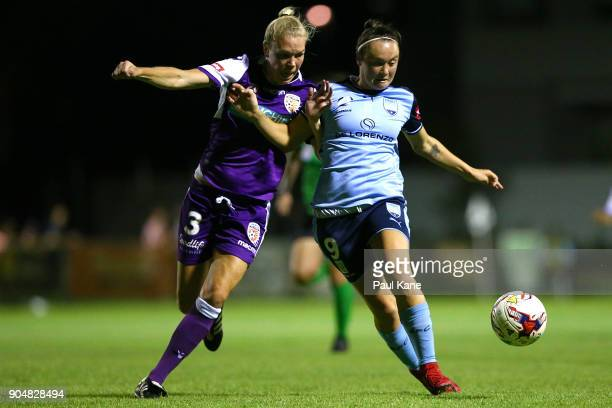 Kim Carroll of the Perth Glory and Caitlin Foord of Sydney contest for the ball during the round 11 WLeague match between the Perth Glory and Sydney...