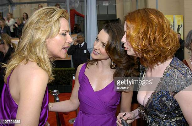 Kim Cattrall Kristin Davis and Cynthia Nixon during 10th Annual Screen Actors Guild Awards Red Carpet at Shrine Auditorium in Los Angeles California...
