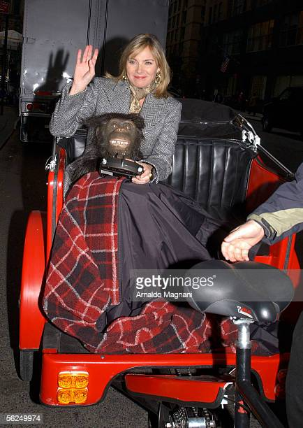 Kim Cattrall rides around Columbus Circle in a Pedicab carying an ape head after filming a segment for the Ellen DeGeneres Show on November 21 2005...