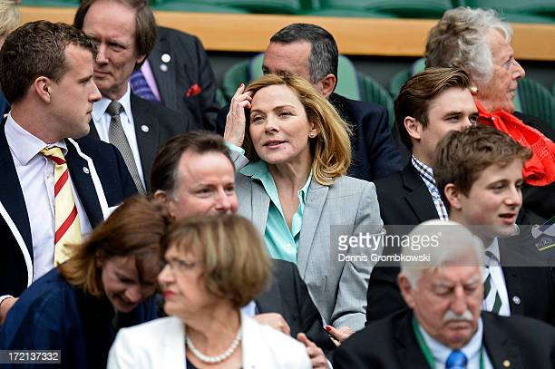 Kim Cattrall sits in the Royal Box before the Ladies' Singles quarterfinal match between Agnieszka Radwanska of Poland and Na Li of China on day...