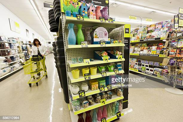 Kim Certisimo of Secaucus shopping at a Dollar General store The store has recently raised the height of its shelving to 78 inches increasing sales...