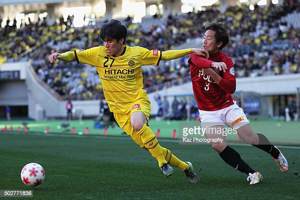 Kim Chang Soo of Kashiwa Reysol and Tomoya Ugajin of Urawa Red Diamonds compete for the ball during the 95th Emperor's Cup semi final match between...