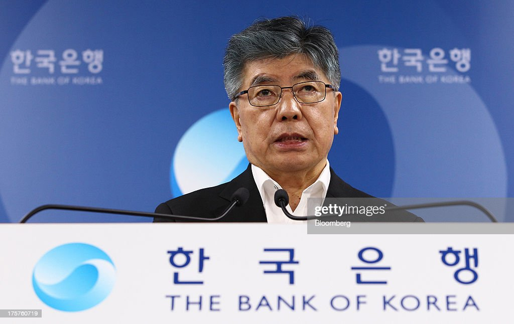 Kim Choong Soo, governor of the Bank of Korea, speaks during a news conference following a monetary policy meeting at the central bank's headquarters in Seoul, South Korea, on Thursday, Aug. 8, 2013. The Bank of Korea held its benchmark interest rate steady, as signs of stronger growth in the U.S. back its view that the economy will gather momentum. Photographer: SeongJoon Cho/Bloomberg via Getty Images