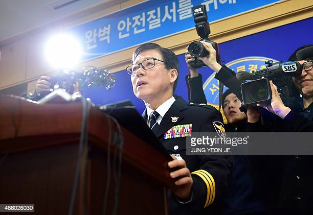 Kim Choul-Joon , a senior South Korea Police Agency officer, speaks during a press briefing at a police station in Seoul on March 13, 2015. South...